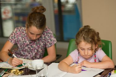 girls colouring the book