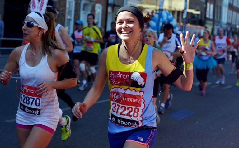 young lady running the marathon for Children With Cancer UK