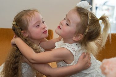 sisters hugging each other