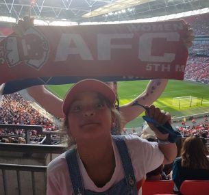 Girl at football match with cap