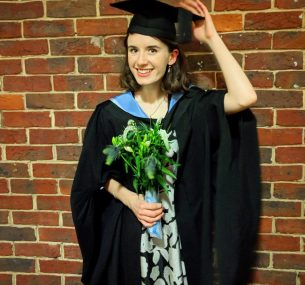 Woman graduating with flowers