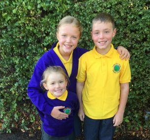 children in school uniform with yellow shirts