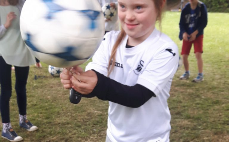 Girl with a football spinning