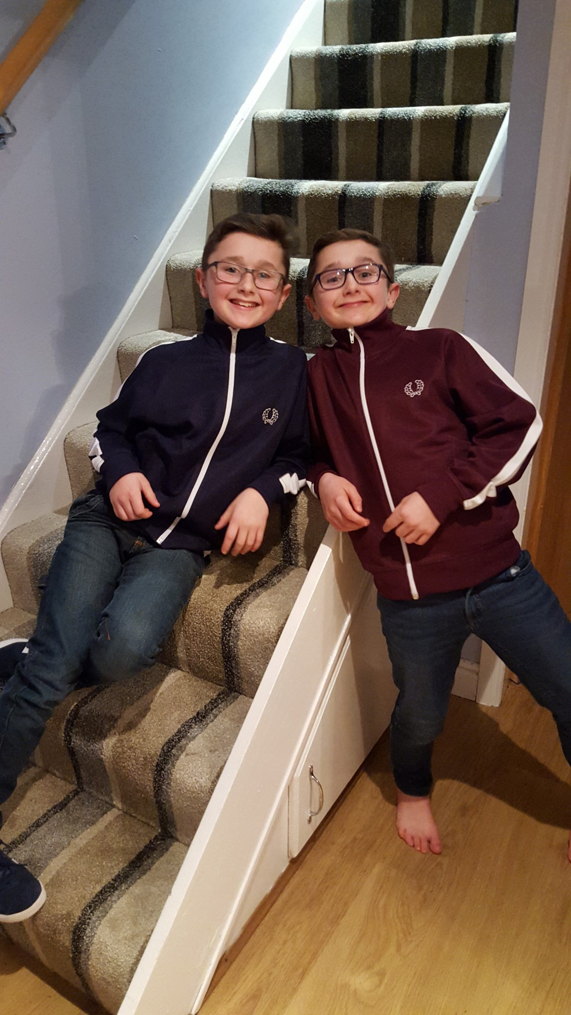 Kai and Ethan sitting on the stairs