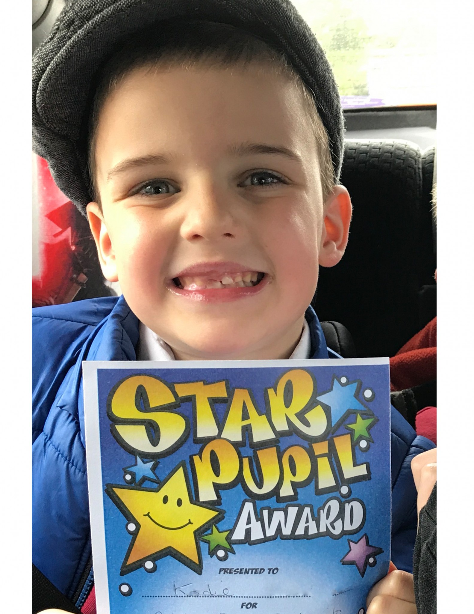 Kodie holding a star pupil award