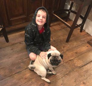boy with pug dog