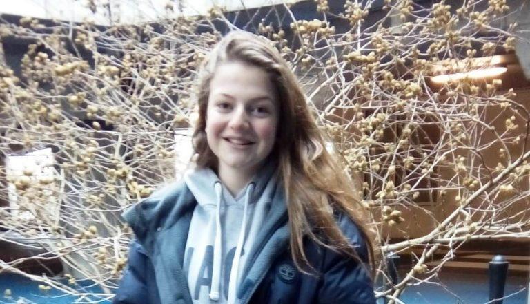 Young girl posing outside
