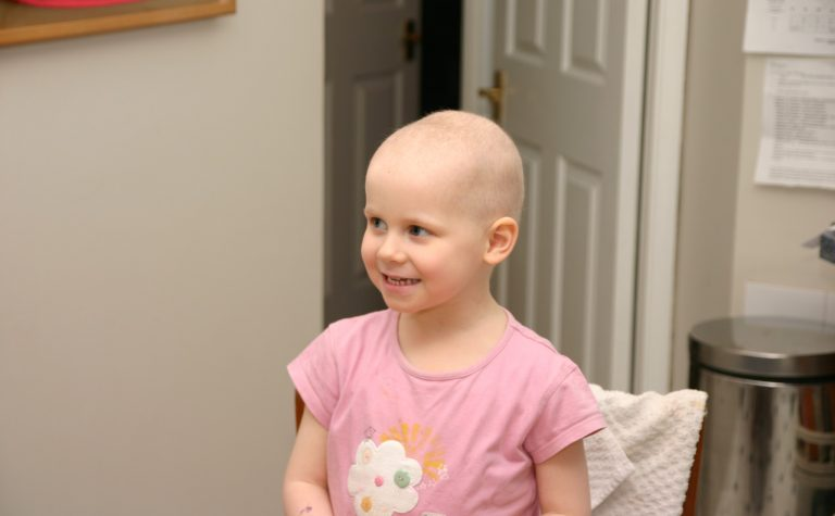 little girl with no hair