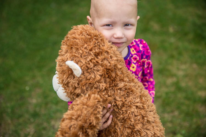 Eva hugging her teddy bear