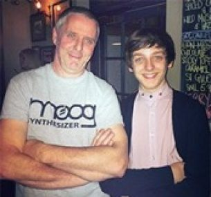 15-year-old Liam with his dad.