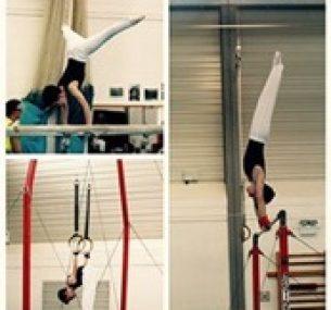 Luke performs gymnastic manoeuvres on apparatus.