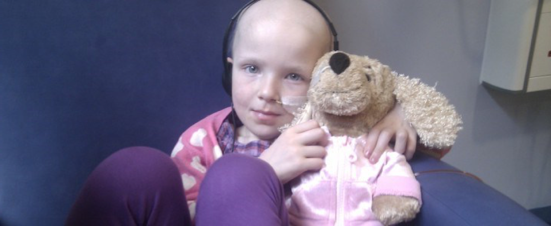 Niamh holds a cuddly toy