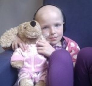 Niamh holding cuddly toy