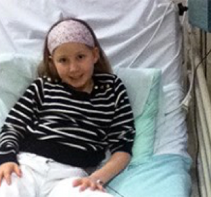Child brain tumour stories: Olivia in hospital bed