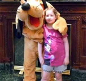 Olivia at Disneyland Paris, stood with Pluto