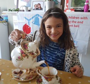 Girl with teapot pouring tea