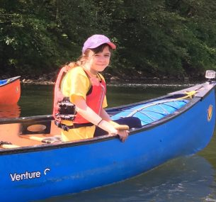Tara girl in a blue canoe boat