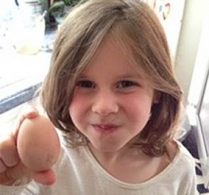 girl holding an egg