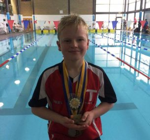 Ross with swimming medals (4)