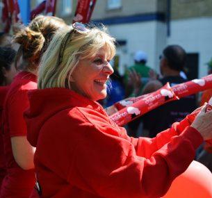 Women cheering people running London marathon for charity