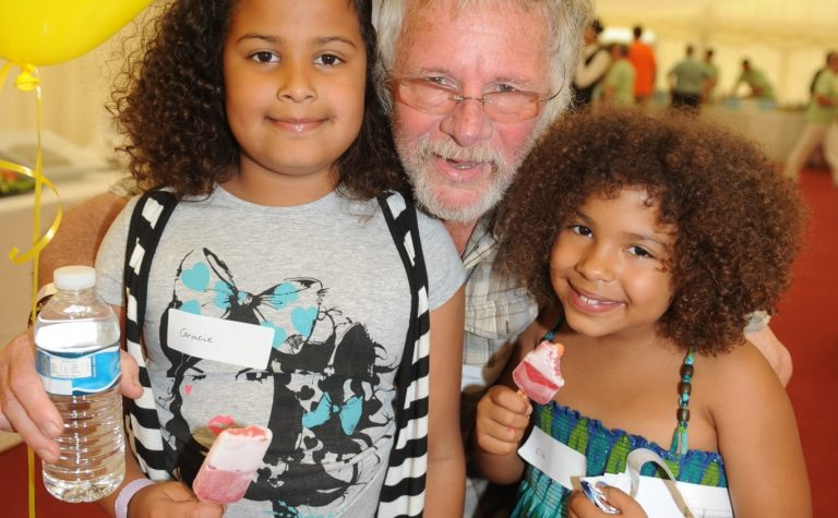 Two girls pose with Bill Oddie