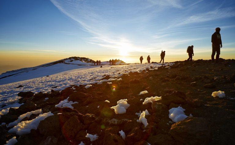 Hikers climb Kilimanjaro at sunrise