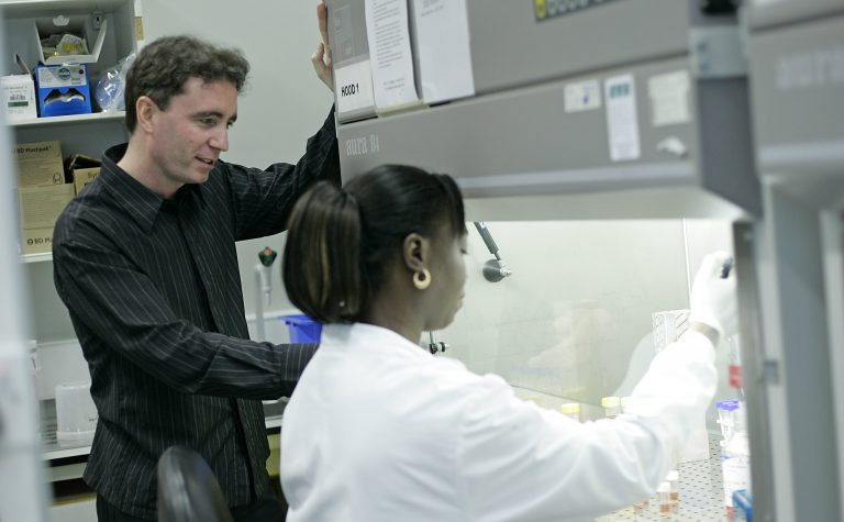 a man and a woman in a laboratory