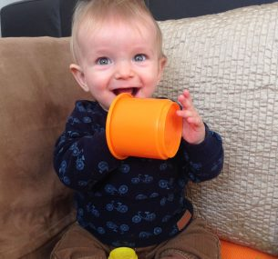 Albie baby boy with orange cup