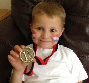 Jacob with medal at school sport event