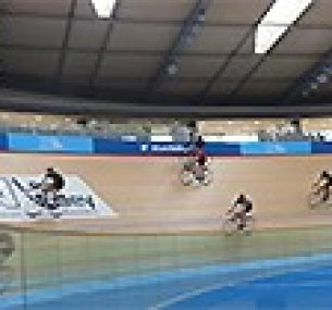 Cyclists going round a velodrome