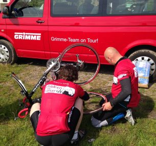 Two cyclists repair a puncture