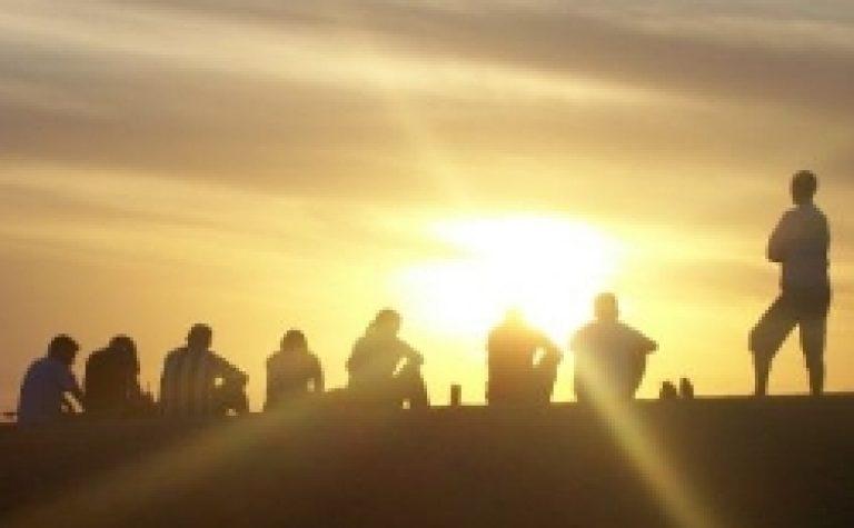 People sitting at sunset