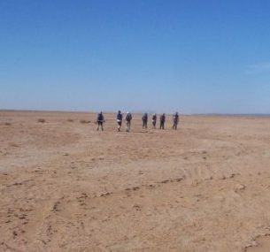 People in the middle of desert