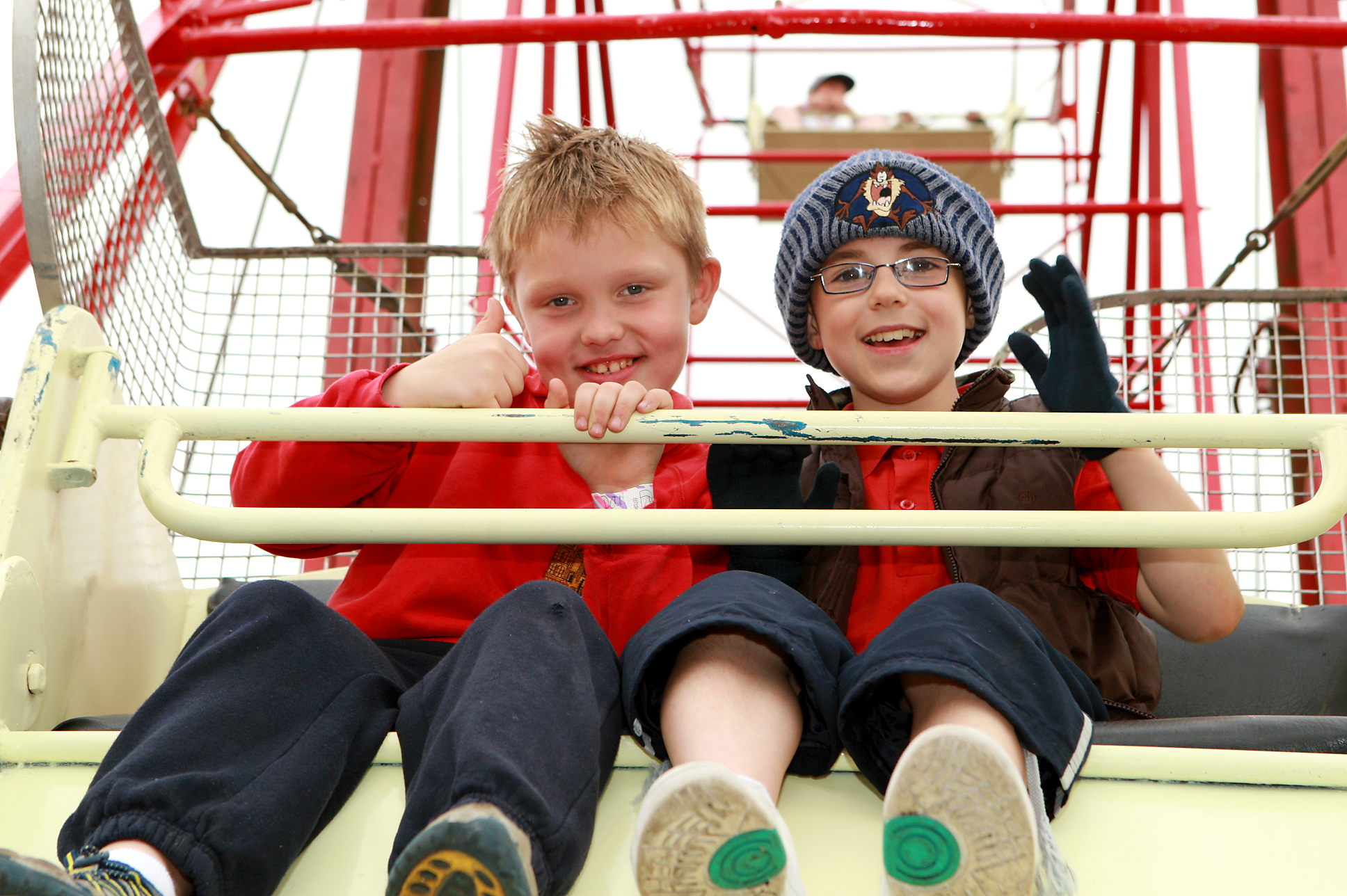 Two young boys on a ferris wheel