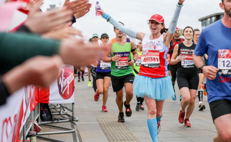 Girl in tutu running the marathon for Children with Cancer UK