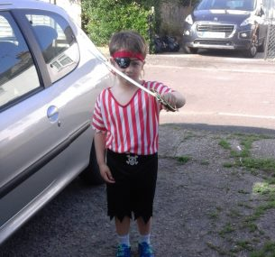 Dominic with sword and pirate outfit