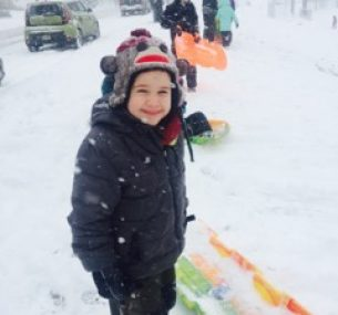 a boy playing in the snow