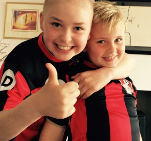 Felix and brother in AFCB Bournemouth football shirts