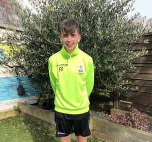 Boy in green football gear