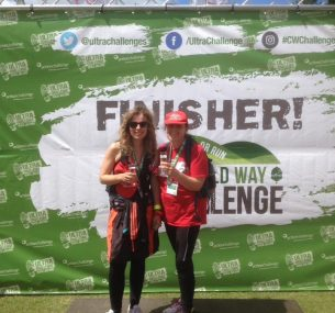 two women with medals and red cap and t-shirt ultra challenge
