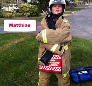Matthias boy in fireman outfit suit