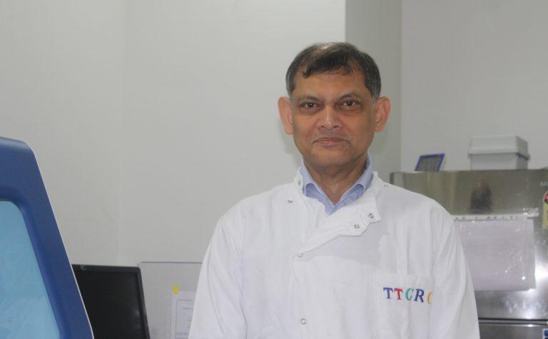 Researcher in white lab coat