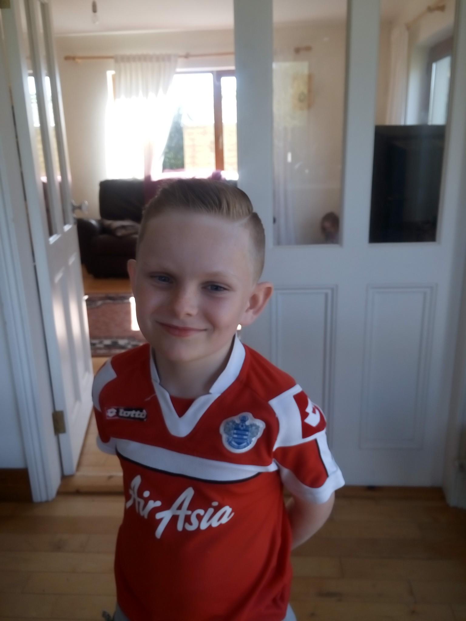 boy wearing red football shirt