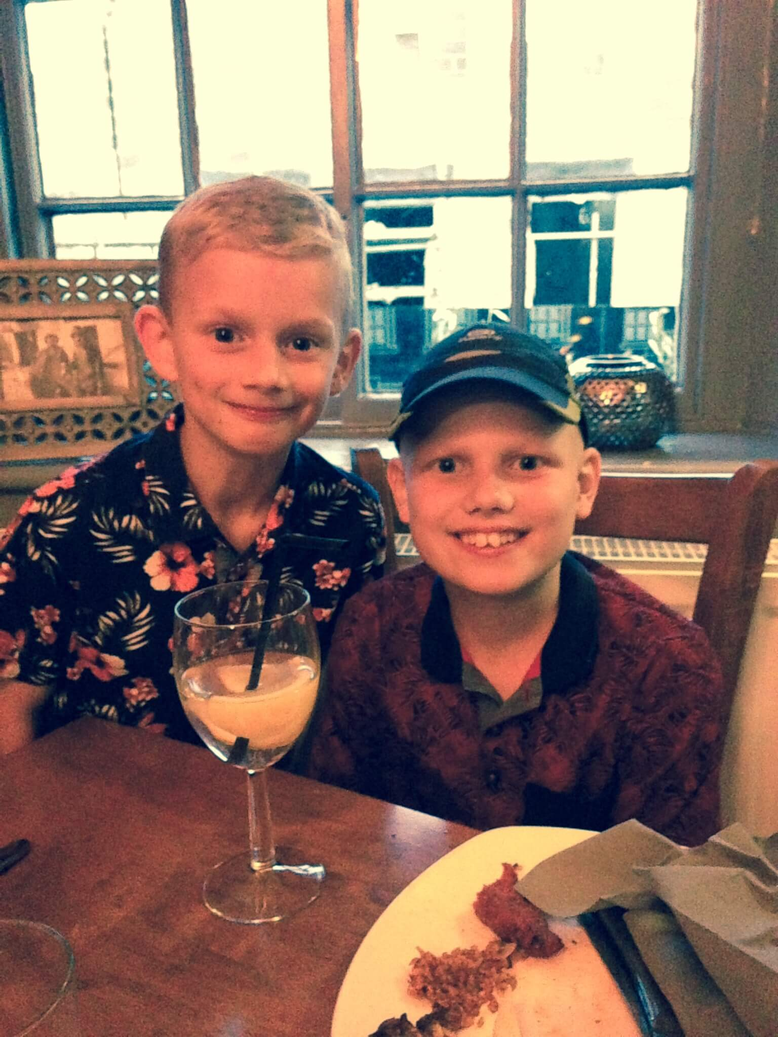 Isaac and brother Noah at meal at end of phase 4