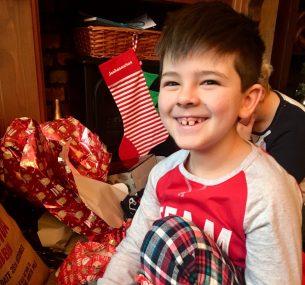 boy in pyjamas josh at christmas 2018