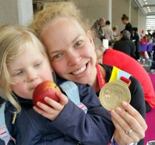 Mum and girl with medal