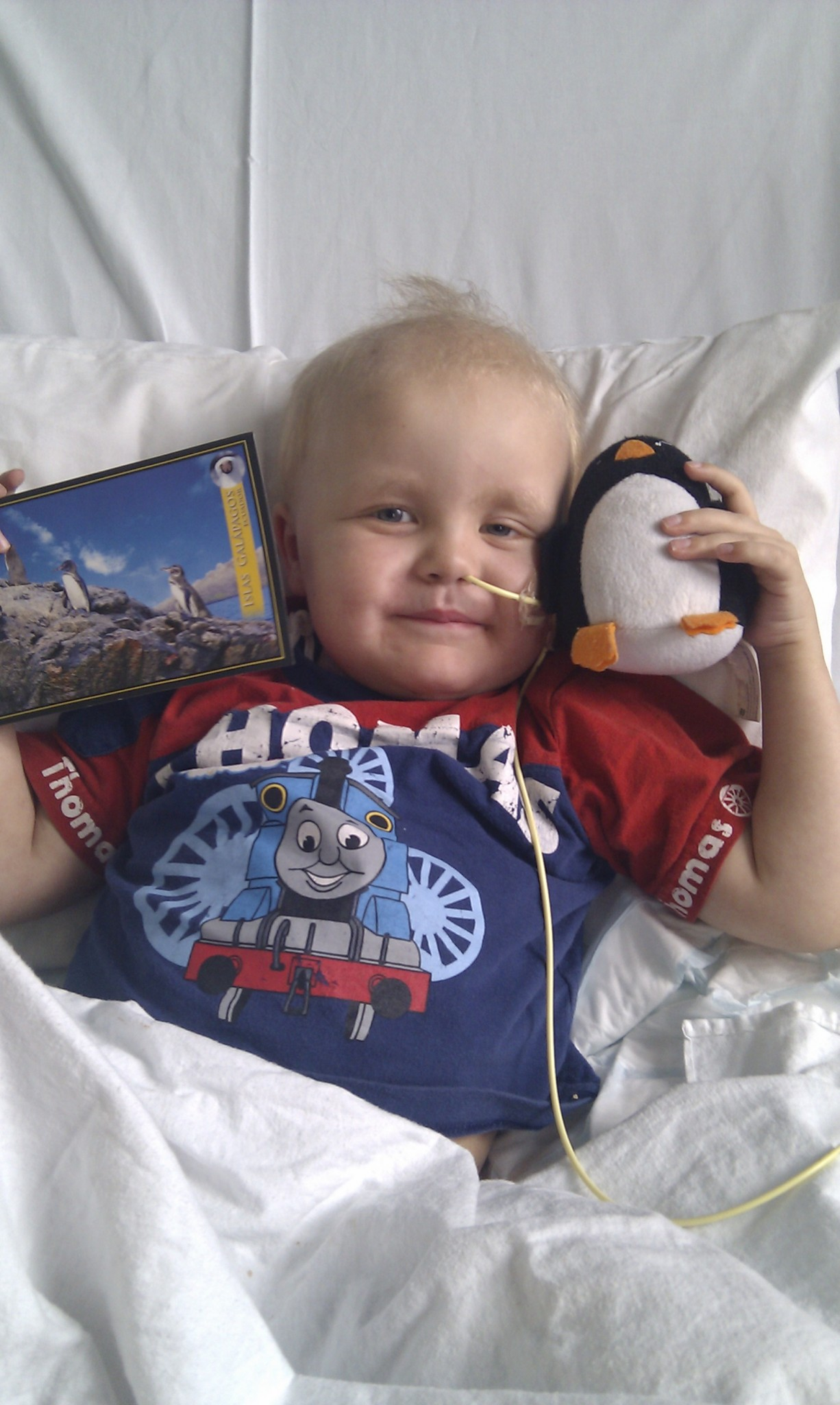 Alex in hospital with his gifts