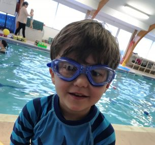 Sebastian boy in swimming goggles