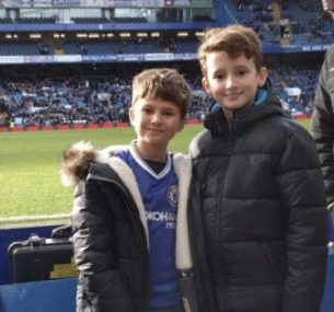 two boys at chelsea football match