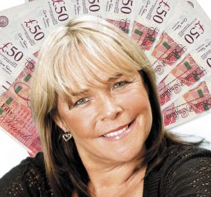 Linda Robson with £50 notes in the background